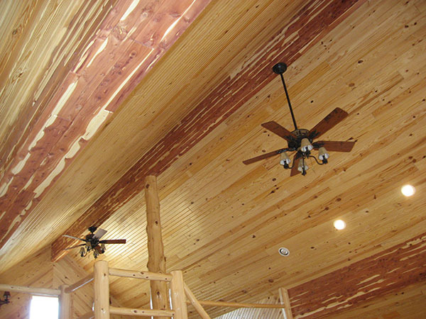 Cedar-wrapped beams inside custom cabin