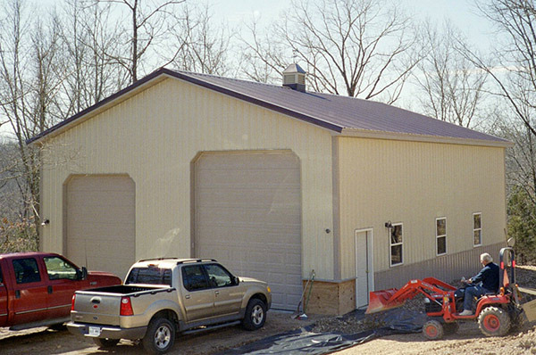 Framed garage with overhead doors