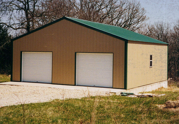 Framed garage on slab with overhead doors